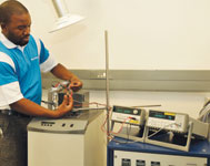 Comparison procedure in a calibration bath being performed by Endress+Hauser quality and metrology technician Mboni Tshifhango