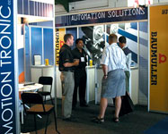 Bradley Douglas and visitors on Motion Tronic's stand at Propak 2007
