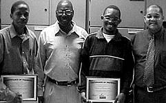 Seen here during the certification hand-over are from left to right: – Calvin Motlhankana, Kenny Sinyinza (section engineer), Cosmos Letlole and Gordon van der Merwe (training officer – RBF)