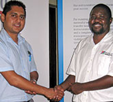 Branch committee member Lucky Penduka (right) thanks Alwin Lutchman after the presentation.
