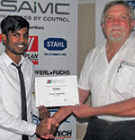 Jared Sigamoney (left) of UKZN, the winner of the Student Award Scheme for the 2nd semester 2018, receiving his certificate from Hennie Prinsloo.